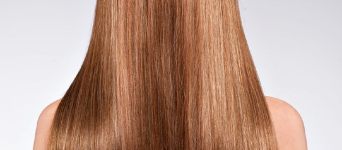 rear-view-woman-with-long-hair-studio_186202-6487