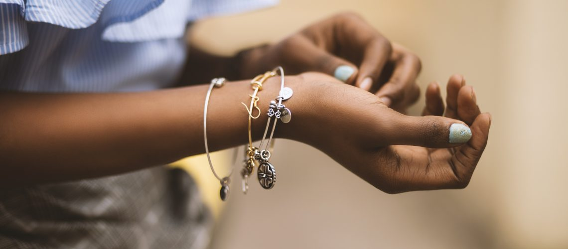 selective-focus-photography-of-person-wearing-three-bangles-1191531